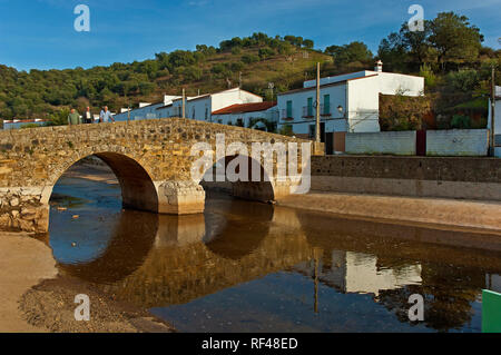 Roman bridge over the river Galindon. San Nicolas del Puerto. Sierra Norte Natural Park. Seville province. Region of Andalusia. Spain. Europe - Stock Image