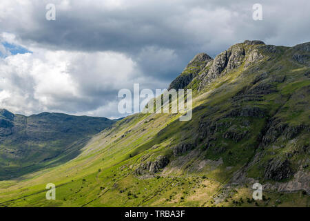 Pike O'Stickle and Loft Crag  - aka the Langdale Pikes  at the head of the Langdale Valley in the Lake District - Stock Image