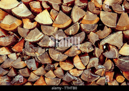 A stack of chopped wood in Cortina D'Ampezzo, Dolomites, Italy - Stock Image