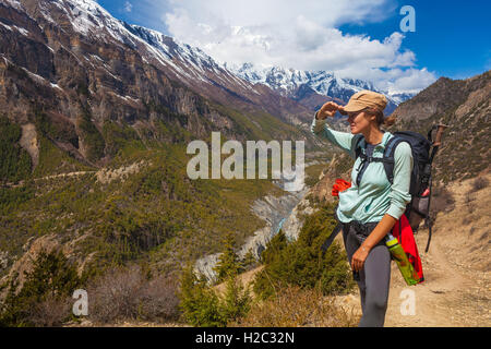 Beautiful Woman Traveler Backpacker Mountains Path.Young Girl Looks Horizon Take Rest.North Summer Landscape Background. - Stock Image