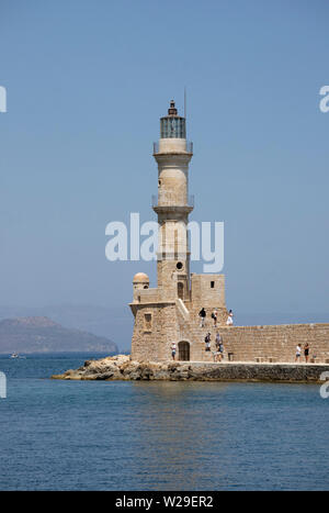 Chania, Crete, Greece. June 2019.  The lighthouse at the end of a long mole along the Old Venetian Harbour in Crete. Erected 16th Century and renovate - Stock Image