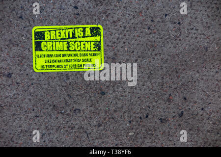 Brexit is a Crime Scene - an anti Brexit sticker on the pavement - Stock Image