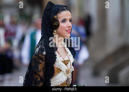 Woman dressed in traditional costume at the annual procession for  the offerings to the Lady of the Forsaken Valencia - Stock Image