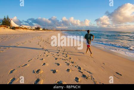 A man running at Leighton Beach - Stock Image