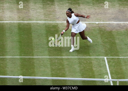 London, UK. 13th July, 2019. The All England Lawn Tennis and Croquet Club, Wimbledon, England; Wimbledon Tennis Tournament, Day 12;  Serenea Williams (usa) returns to Simona Halep (rom) during the womens singles final match Credit: Action Plus Sports Images/Alamy Live News - Stock Image