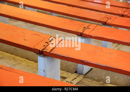 Rows of empty wooden stadium seats . close up - Stock Image