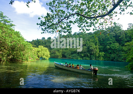 Jamaica Port Antonio Tropical landscape at blue lagoon tour boat with tourists - Stock Image