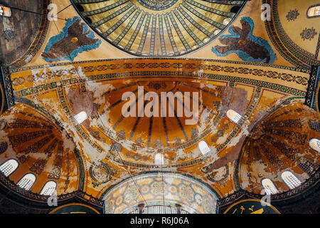 Istanbul, Turkey - August 14, 2018: The dome (ceiling) decoration of the Hagia Sophia Museum, view from inside the temple on August 14, 2018, in Istan - Stock Image