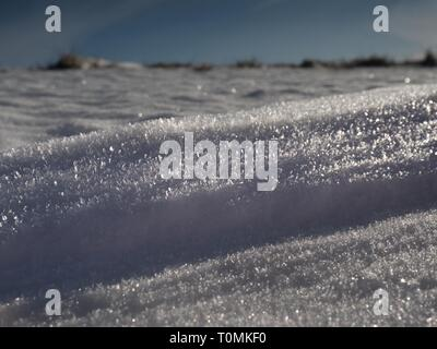 Sharp snow texture. Winter landscape,  snow field sparkling in the sun, shinnig surface - Stock Image