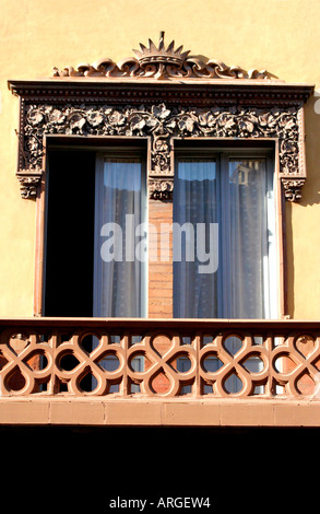 detail of a charning window and balcony of the palazzo Corona Tolentino Le Marche Italy - Stock Image