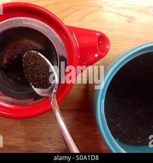 Colourful teapot and jar, making a pot of tea. - Stock Image