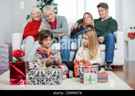 Three Generation Family With Christmas Presents - Stock Image
