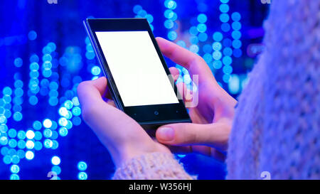 Mock up concept - smartphone with white empty display at scifi show - Stock Image