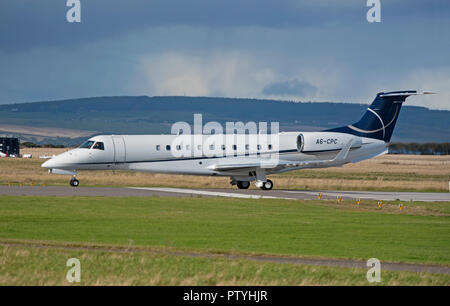 An ERJ 135 Legacy aircraft oowned by Gamma Aviation on the runway AT Inverness Dalcross airport having just arrived. - Stock Image