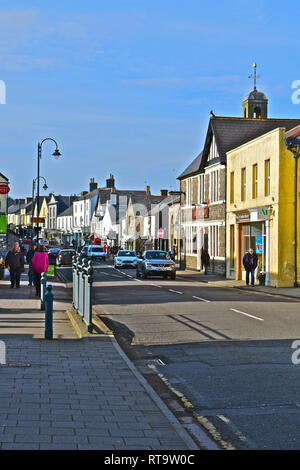 A street view of the High Street in the Welsh market town of Cowbridge, with it's mix of famous brands and small local specialist shops - Stock Image