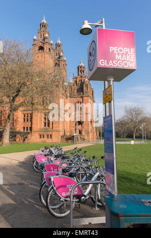 People Make Glasgow Next bike stand with an array of bicycles to rent near Kelvingrove Museum, Glasgow, Scotland, - Stock Image