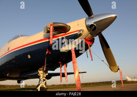 'Remove Before Flight' ribbons, propellers and Pratt & Whitney Canada PT6A-67B engine-cowling of Pilatus PC-12-45 parked - Stock Image