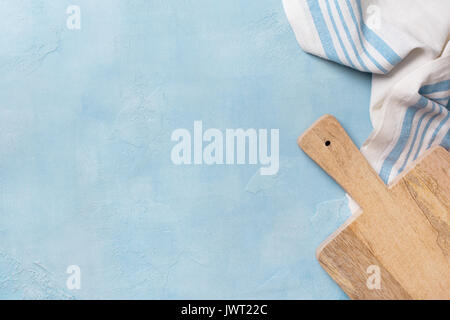 napkin, cutting board on a blue background concrete. view from above. copy space - Stock Image