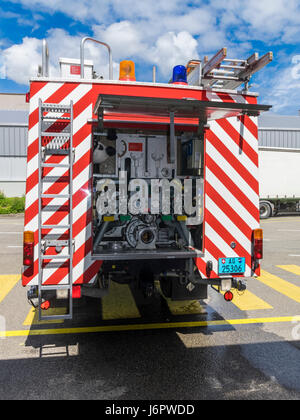 Mercedes Benz 1428AF water tender of a Swiss fire brigade. Rear view of with water pump controls and valves. - Stock Image