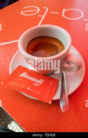 Portugal, Porto, Matosinhos, Rua de Brita Capelo, cup of Buondi espresso coffee on pavement café  table - Stock Image