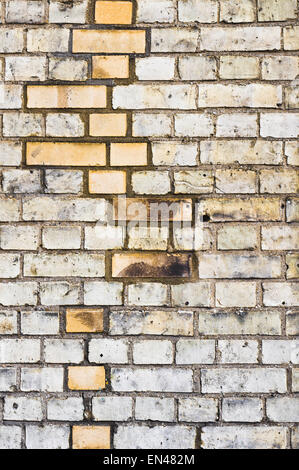 Pattern of newer and older bricks in a wall - Stock Image