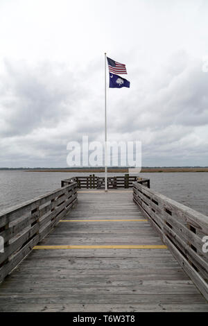 The flags of the United States of America and South Carolina flying on a flagpole. The Stars and Stripes flies above the South Carolina state flag, wh - Stock Image