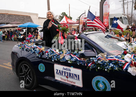 Texas state Sen. Judith Zaffrini waves from the back of a convertible during the annual Washington's Birthday Celebration parade in Laredo, Texas. - Stock Image