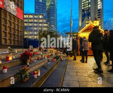 Berlin Breitscheidplatz memorial at Christmas Market, Berlin City Weihnachtsmarkt, for the12 victims of 2016 terror attack. Visitors lighting candles. - Stock Image