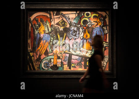 London, UK. 16 June 2017. A Christie's employee poses with the painting Birds' Hell (Hoelle der Voegel), - Stock Image