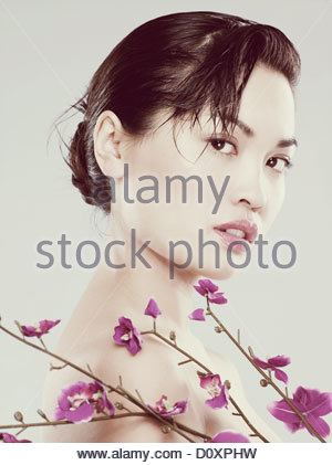 Young woman with flowers - Stock Image