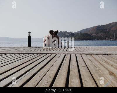 Kissing Couple on Holiday - Stock Image