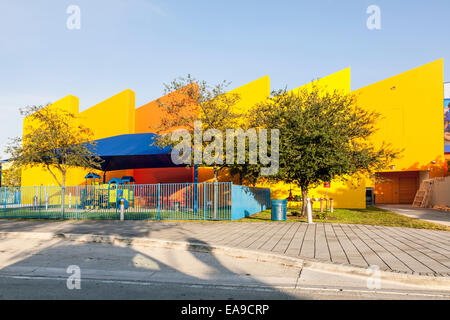 Brightly coloured colored Miami's Children's Museum fenced playground with shade awning in Miami Florida, - Stock Image