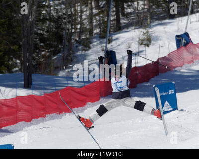 Quebec,Canada .Freestyle Canada ,Brooke Armstrong performs a spread eagle at the National Freestyle Moguls Championship at Val Saint-Come - Stock Image