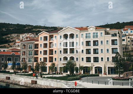 Beautiful view of residential buildings or modern architecture or residential area in Lustica Bay in Montenegro. - Stock Image