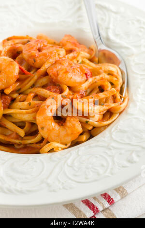 Spicy prawn linguine in a chili and tomato based sauce - Stock Image