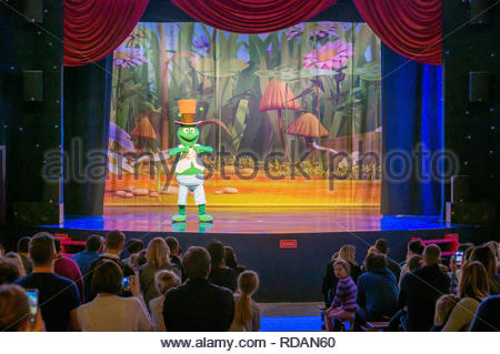 Kownaty, Poland - January 6, 2019: Person dressed as cricked performing on a stage in front of a audience in the Majaland attraction park. - Stock Image
