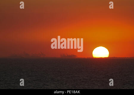 UK: 4 August July 2018: Sunset over the North Sea from a sea vessel sailing from the river Thames estuary on 4 August. Temperatures in the UK remains in the high 30's degrees for a third week running Credit: David Mbiyu/ Alamy Live News - Stock Image