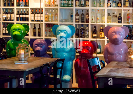 Colorful ceramic bears guard the wine and liquor cellar of the Brickell Miami restaurant, Crazy About You on Biscayne - Stock Image