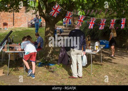 Union Jack bunting decorastes the traditional Ewelme Harvest Fete, Oxfordshire, - Stock Image