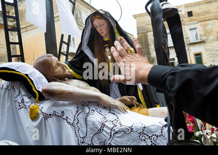 SESSA AURUNCA, ITALY - MARCH 30-31, 2018 - A woman welcomes Vergine Addolorata during the Easter procession on Holy Saturday in Sessa Aurunca, Italy - Stock Image