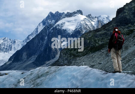 A young woman on the Mer de Glace in Chamonix - Stock Image