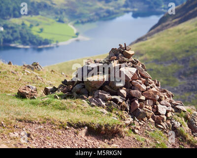 A route Cairn, pile of stones, near the summit of Red Pike in the English Lake District, UK. - Stock Image
