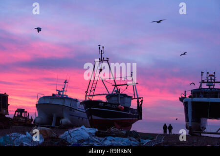 Hastings East Sussex, UK. 27th Dec, 2018. Dawn breaking over the fishing boats on the Old Town Stade beach. With more than 25 boats Hastings has one of the largest beach-launched fishing fleets in Europe. - Stock Image