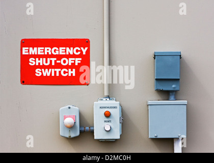 emergency switches on side of building - Stock Image