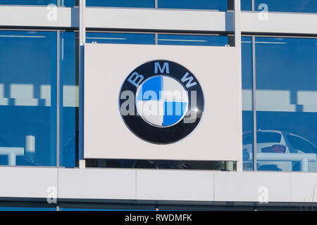 The BMW roundel and logo on the building of Cooper BMW in Reading, Berkshire. - Stock Image