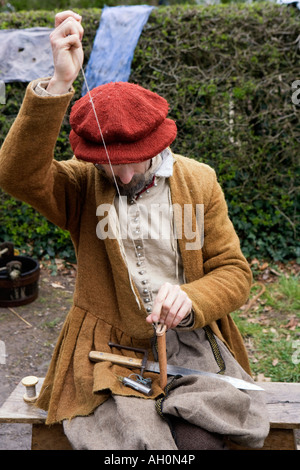 Crafts Person in period costume at Saint Fagan's National History Museum Cardiff Wales Great Britain United - Stock Image