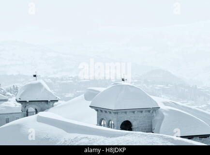 roofs covered by heavy snow - Stock Image