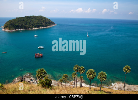 View over coastline island and clear blue water Cape Promthep Phuket Thailand . - Stock Image