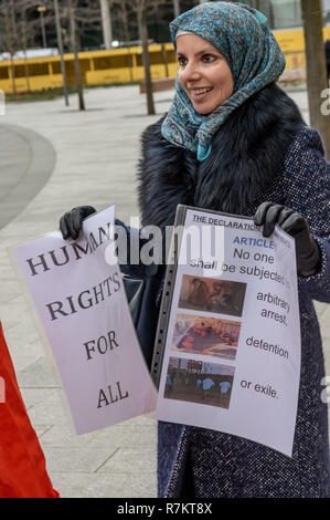 London, UK. 10th December 2018.  A protester at the US Embassy in the final 'Shut Guantanamo!' monthly protest of 2018 on the 70th anniversary of the Universal Declaration of Human Rights (UDHR). This declared 'No one shall be subjected to torture or to cruel, inhuman or degrading treatment or punishment' and 'No one shall be subjected to arbitrary arrest, detention or exile.' Guantanamo still has 40 detainees who have been tortured and held in indefinite detention without trial for almost 17 years. Credit: Peter Marshall/Alamy Live News - Stock Image