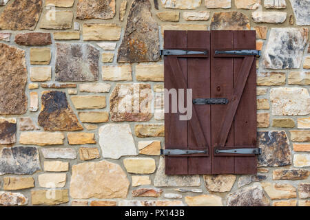 Wood shutters on rock building at I-26 rest stop in Tennessee. - Stock Image
